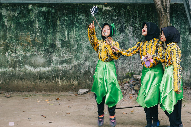 Full length of young women in traditional clothing