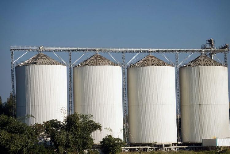 Industrial place, huge metal silo
