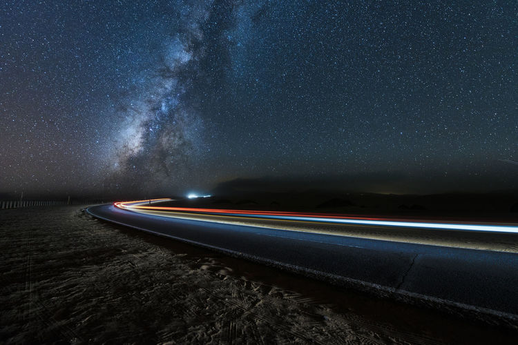 Light Nightphotography Astronomy Beauty In Nature Car Trails Galaxy Illuminated Light Trail Long Exposure Milky Way Motion Nature Night No People Outdoors Scenics Sea Sky Speed Star - Space