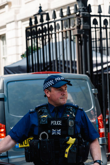 Police officer guarding 10 Downing Street entrance gate in the City of Westminster. 10 of Downing Street is the residence of the Prime Minister of the United Kingdom 10 Downing Street Brexit Britain London Officer Theresa May Uk Architecture Attraction British Building Capital City Conservative Control Crisis Downing Downing Street Election England English European  Famous Fence Gate Government House KINGDOM Landmark Leader Minister Parliament Police Political Politician Politics Power Prime Prime Minister Protection Residence Safety Security Street Terror Terrorism Travel Westminster Whitehall Police Force