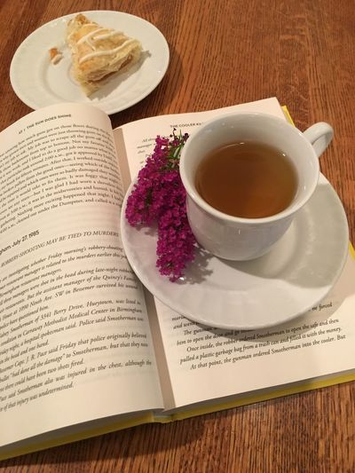 Relaxing time with a cup a tea and a book Reading A Book Cup Of Tea..  Relaxing Moments Food And Drink Book Publication Drink Refreshment Cup Mug Table Indoors  Still Life Tea Food High Angle View No People
