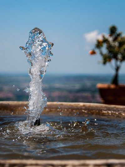 Close-up of water splashing in fountain at park