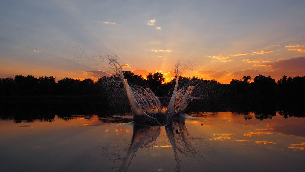Sunset Reflection On Water Water Splashing Reflection Lake Water Selective Focus No People Sunsset Dawn