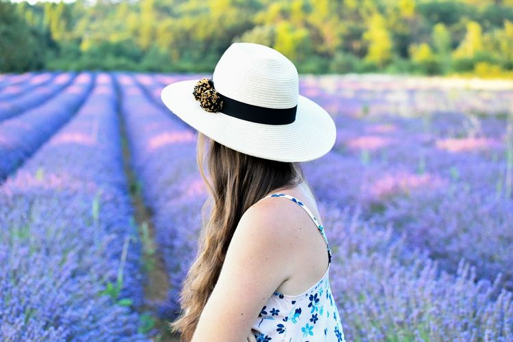 Side View Of Woman Wearing Hat At Lavender Farm