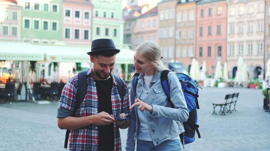 Young man looking at city